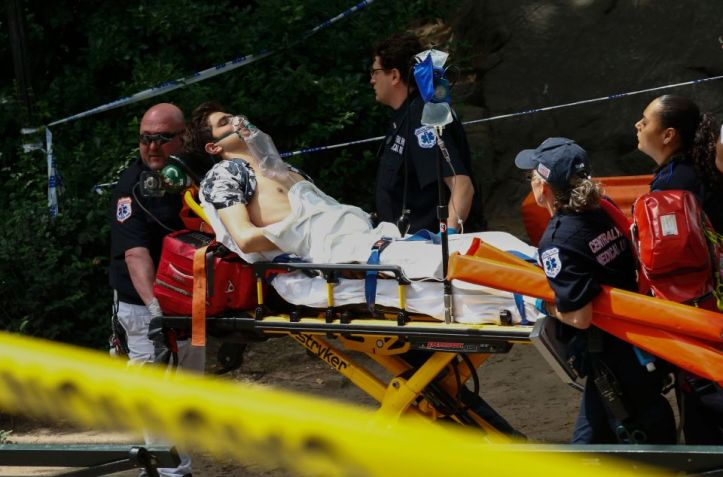 A critically injured man is taken on a s